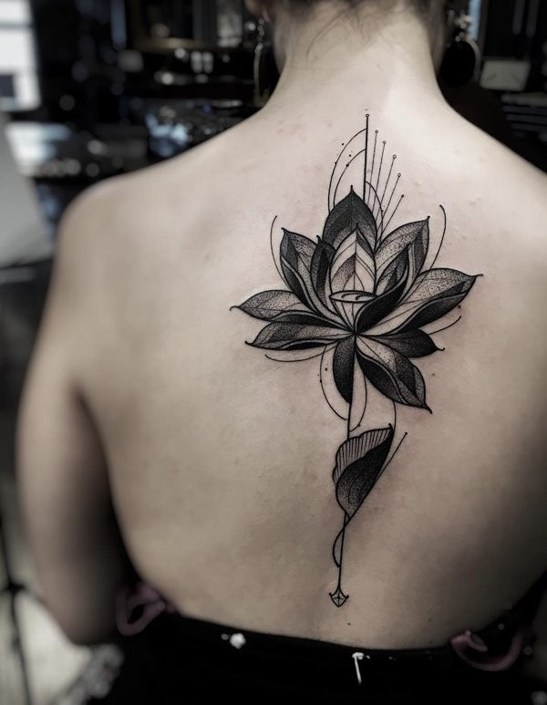 Old style black ink simple back tattoo of big flower