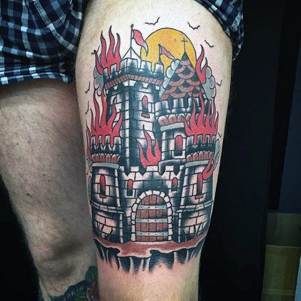 Old style colored detailed castle on fire massive thigh tattoo