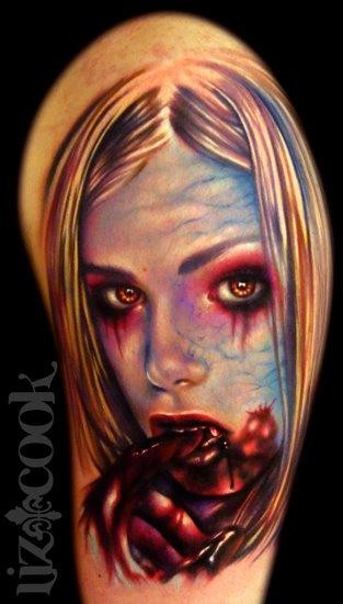 Old style creepy designed and colored bloody vampire girl tattoo on shoulder