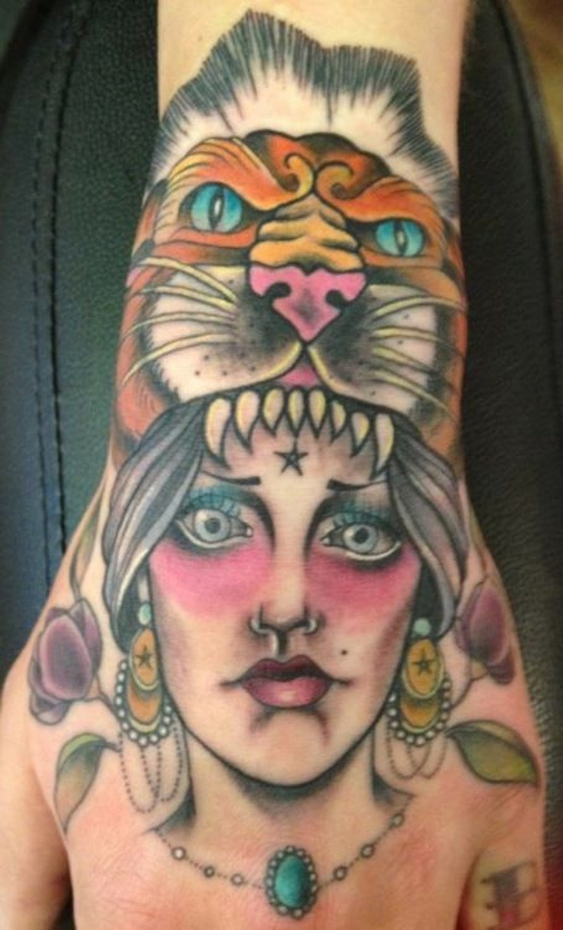 Old style designed and colored small hand tattoo of tribal woman with lion skin helmet