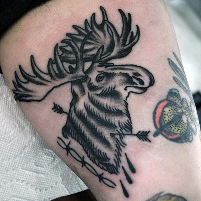 Old style designed black and white elk with arrows tattoo on thigh