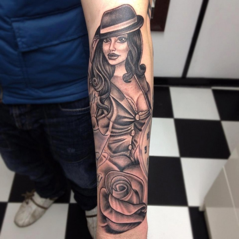 Old style painted black and white seductive woman with flower tattoo on arm
