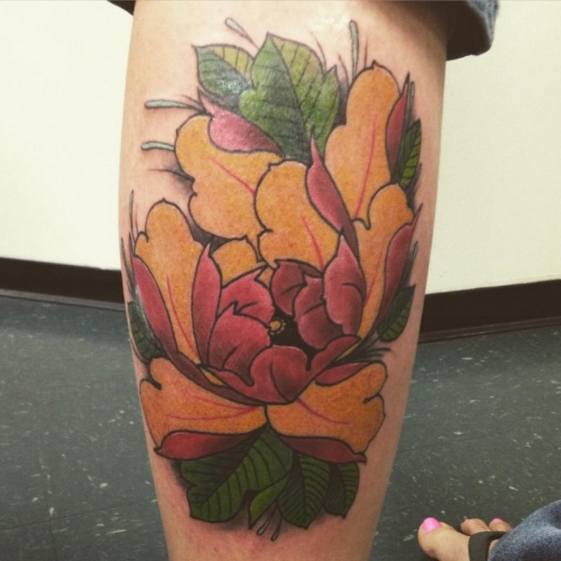 Old style painted colored leg tattoo of beautiful flower