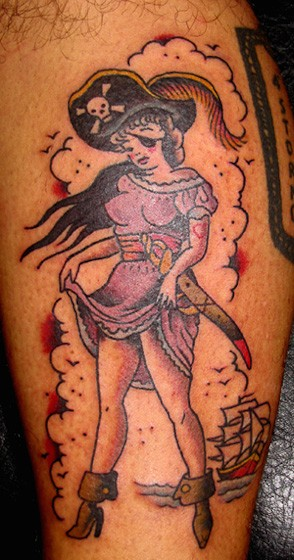 Old style painted simple pirate woman tattoo on leg