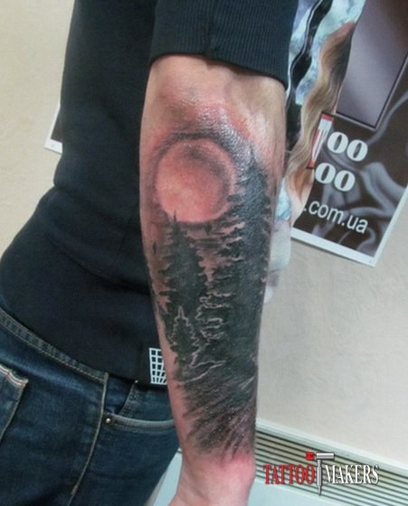 Old very realistic night forest tattoo on sleeve