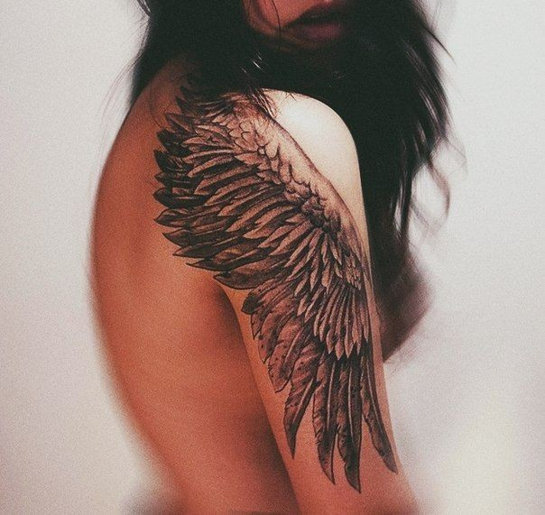 One black wing tattoo on shoulder for girls