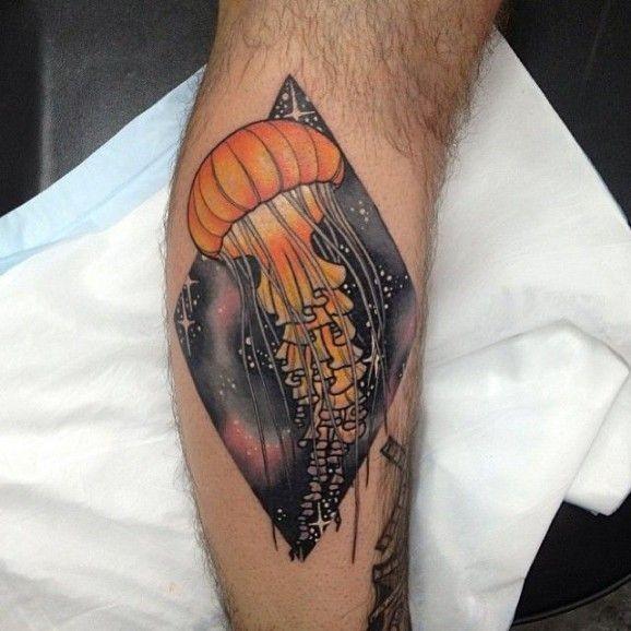 Orange jellyfish tattoo on leg