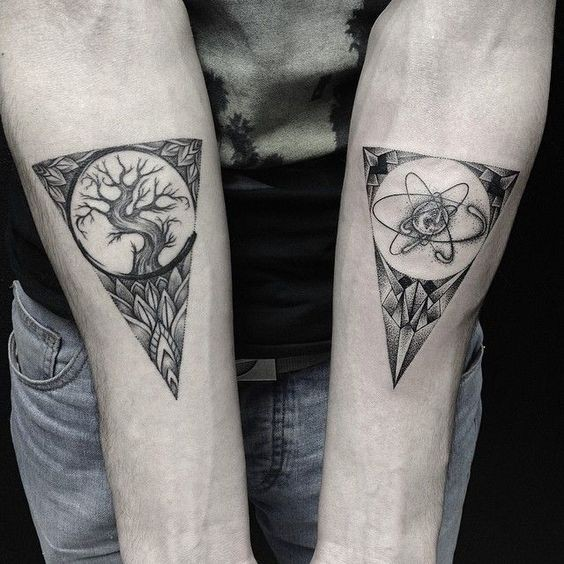 Original back ink triangles with tree and atom tattoo on forearms