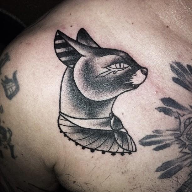 Original black and white shoulder tattoo of Egypt cat