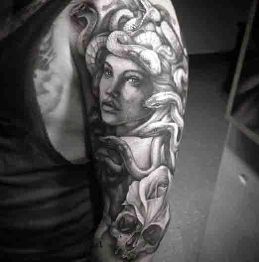 Black Medusa Tattoo: Original Black Ink Antic Medusa Tattoo On Shoulder With