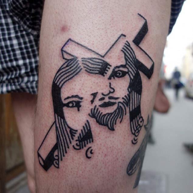 Original black ink cross with Jesus tattoo on leg