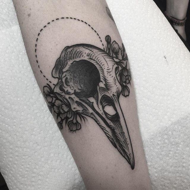 Original black ink forearm tattoo of birds skull and flowers