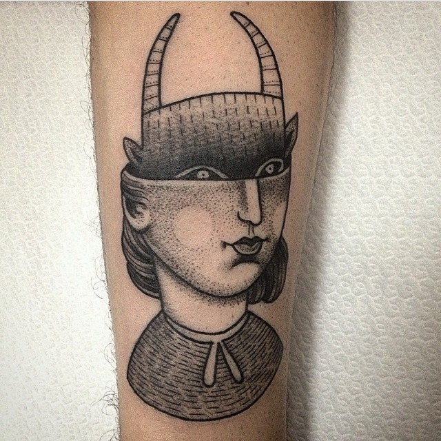 Original black ink forearm tattoo of half human half devil