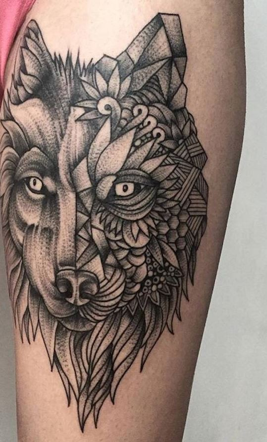Original black ink mystical wolf tattoo stylized with tribal ornaments