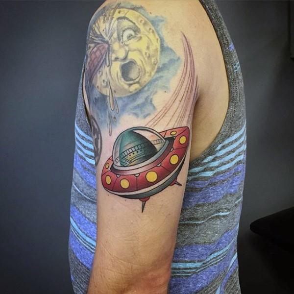 Original cartoon like colored alien ship tattoo on shoulder with Moon