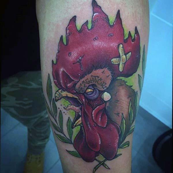 Original colored evil cock fighter tattoo on leg