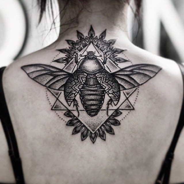 Original combined big black ink insect with geometric figures tattoo on upper back