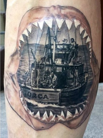 Original combined big shark mouth stylized with old fishing ship tattoo on thigh