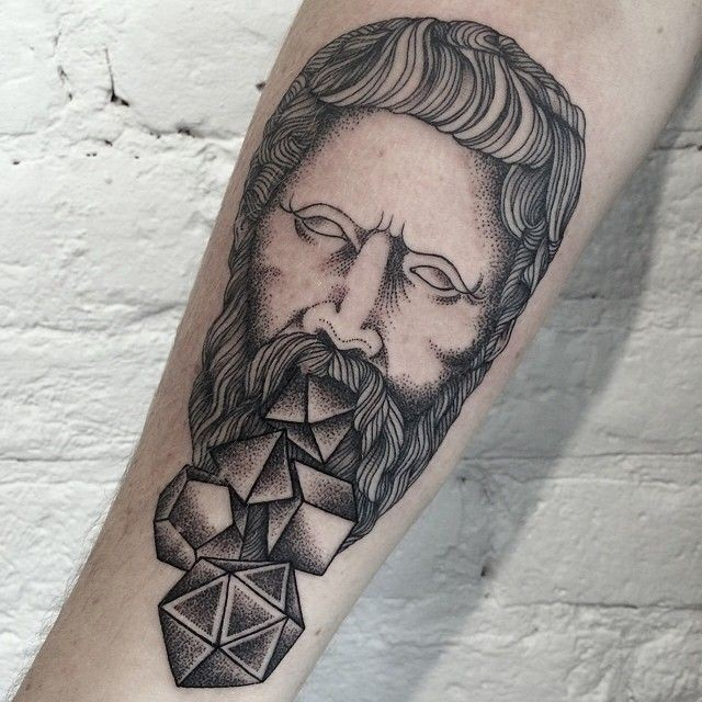 Original combined black ink antic statue tattoo on forearm with geometrical figures