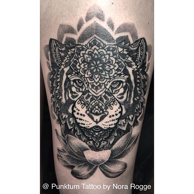 Original combined black ink tattoo of tiger head stylized with various flowers
