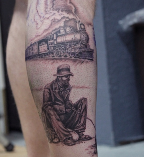 Original combined colored leg tattoo of steam train and sad clown