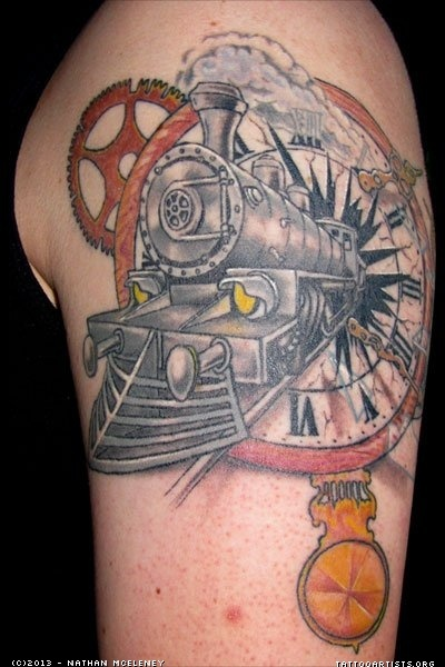 Original combined large upper arm tattoo of broken clock with train