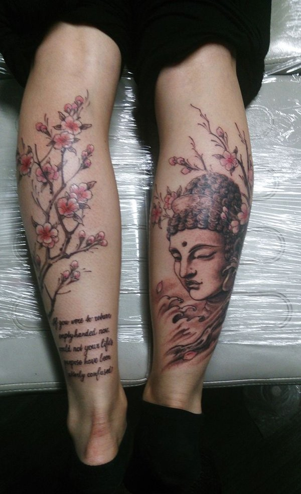 Original combined legs tattoo of Buddha statue, blooming tree and lettering