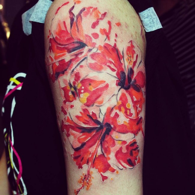 Original design colored hibiscus flowers tattoo on shoulder in watercolor style
