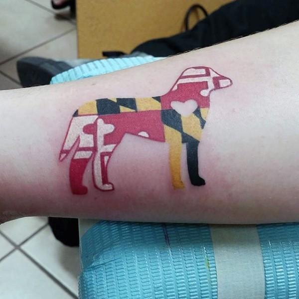 Original design multicolored stylized dog shaped tattoo