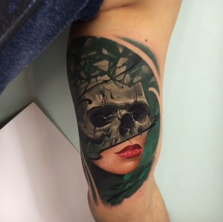 Original designed and colored biceps tattoo of woman face stylized with skull