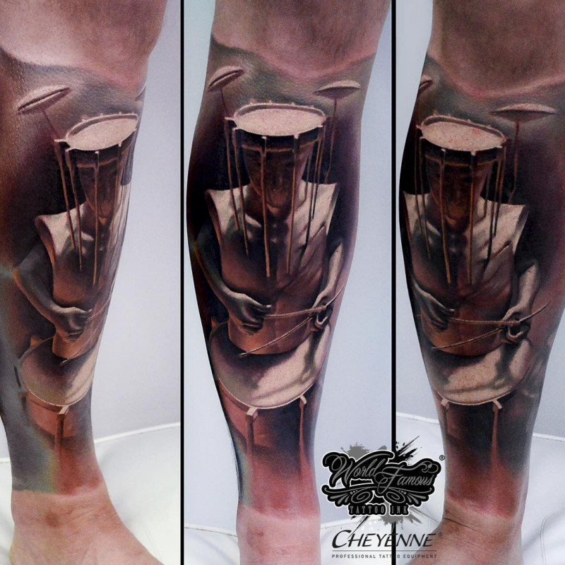 Original designed and colored leg tattoo of human with drum head