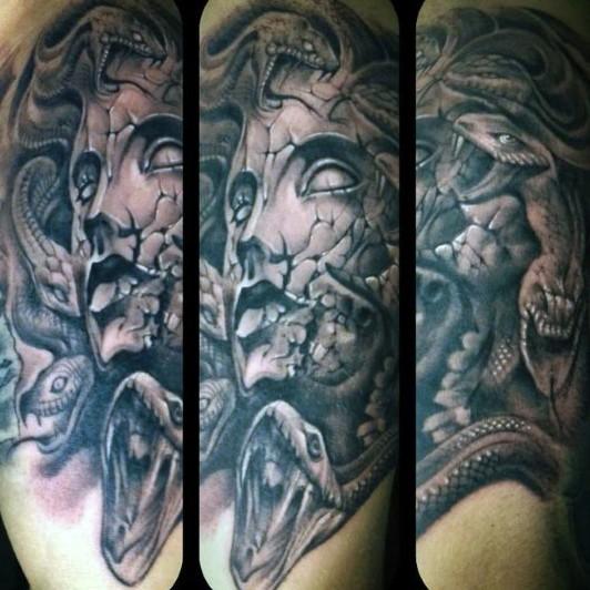 Original designed black and white corrupted Medusa head tattoo on shoulder
