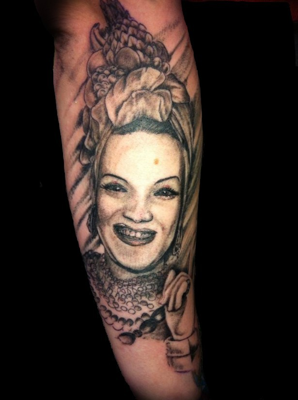 Original designed black ink woman portrait tattoo on forearm stylized with various fruits