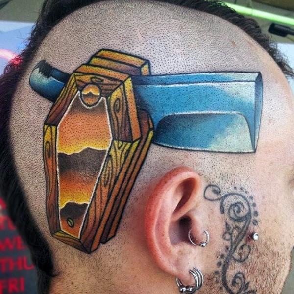 Original designed coffin shaped razor blade tattoo on head