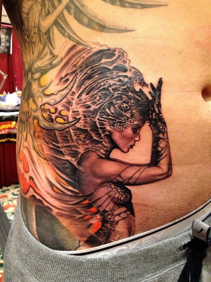 Original detailed belly tattoo of seductive fantasy woman