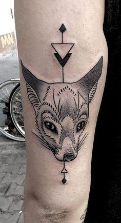 Original looking black ink arm tattoo of fantasy fox and geometrical ornaments