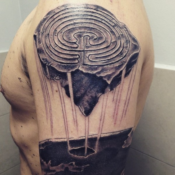 Original looking black ink shoulder tattoo of mystical stone with ornaments