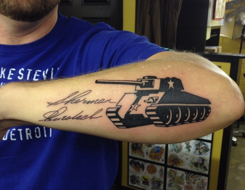 Original looking blackwork style arm tattoo of military tank with lettering
