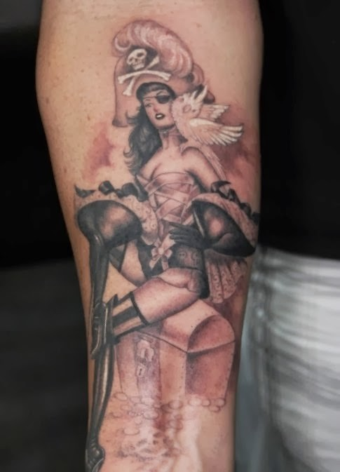 Original painted big black and white sexy pirate girl with treasure chest tattoo on arm