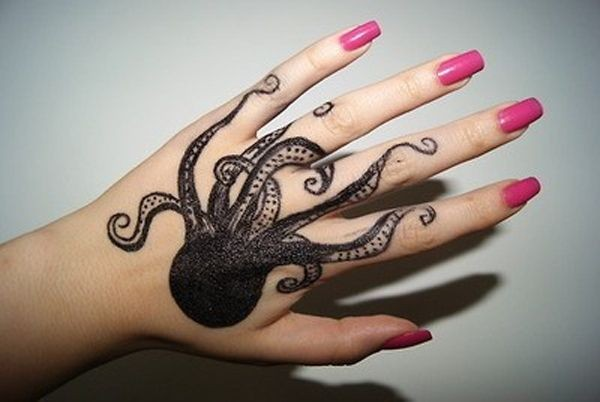 Original painted black and white little octopus tattoo on hand