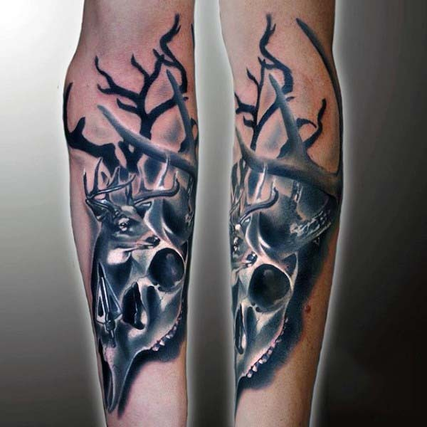 Original painted black ink animal skull with deer tattoo on arm