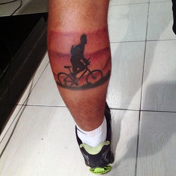 Original painted colored bike rider tattoo on leg