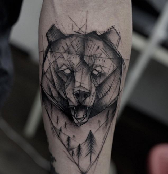 Original sketch style black ink bear head tattoo on forearm with forest