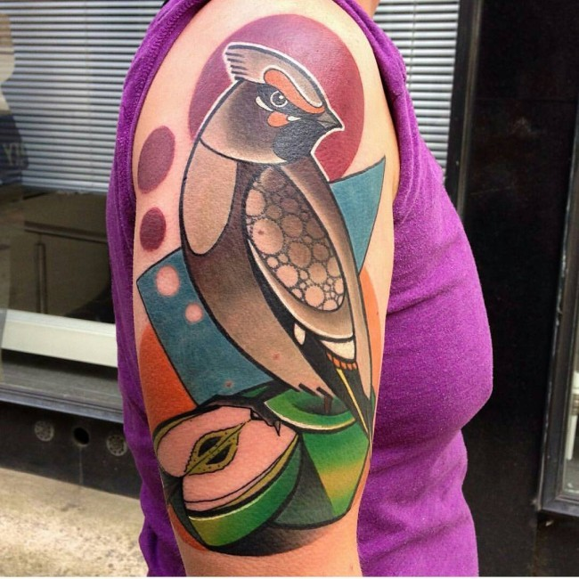 Original style painted and colored bird tattoo on shoulder with apple part
