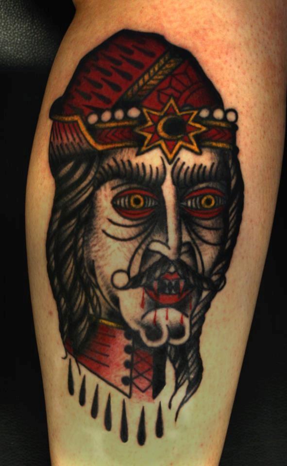 originale stile dipinto grande testa sanguinante di vampiro colorato tatuaggio su gamba