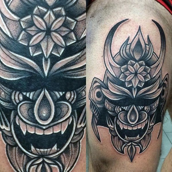 Ornamental style black ink awesome samurai mask tattoo on thigh