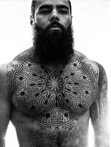 Ornamental style black ink chest tattoo of big ornament