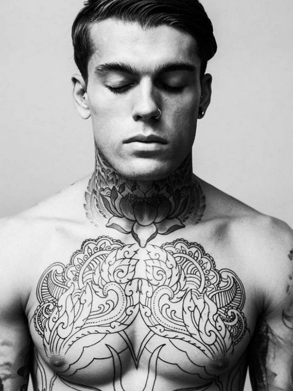 Ornamental style black ink flowers tattoo on chest