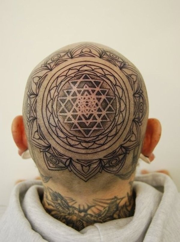 Ornamental style black ink head tattoo of awesome ornament