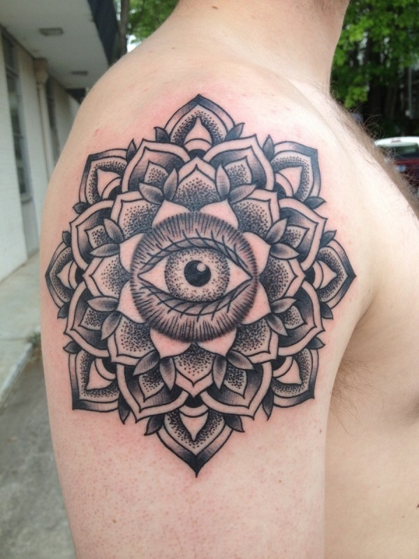 Ornamental style black ink shoulder tattoo of mystical flower with eye